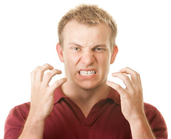 Image of a man grinding his teeth