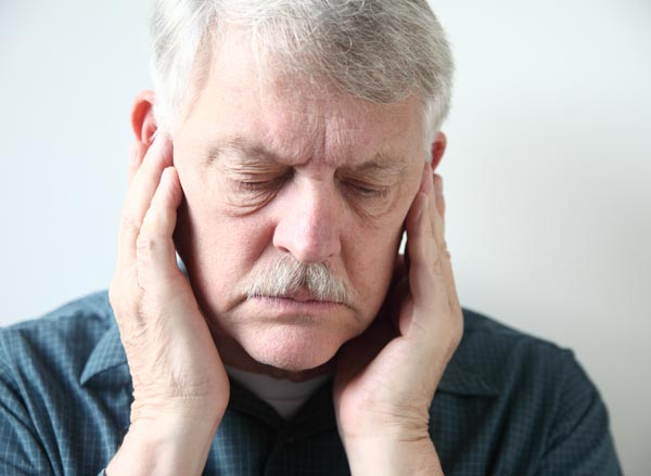 Image of a man suffering from TMJ in Thornton
