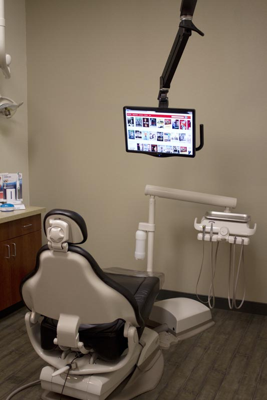 Image of a dental chair showing the entertainment system as well at HighPointe Dental in Thornton, CO.