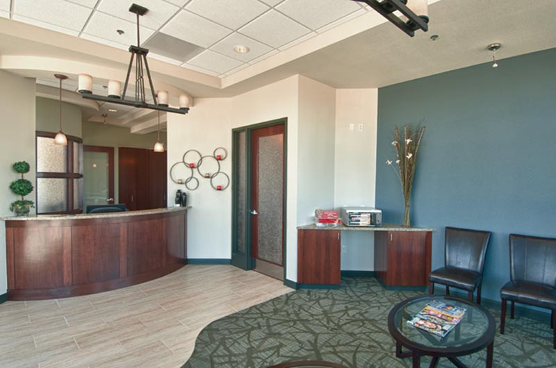Image of the waiting room looking toward the front desk at HighPointe Dental in Thornton, CO.
