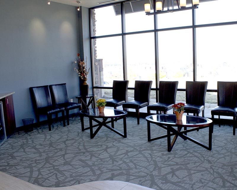 Image of the waiting room looking out from the hall at HighPointe Dental in Thornton, CO.