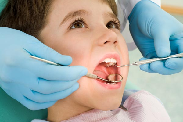 Image of a child getting a dental exam