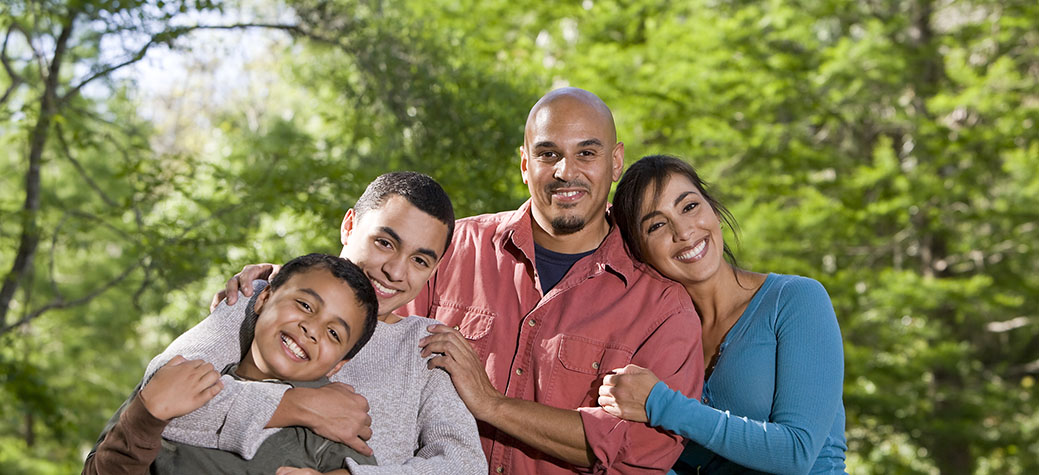 Portrait of Hispanic Family with Excellent Dental Care
