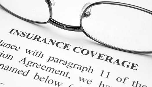 Image of glasses on an insurance policy