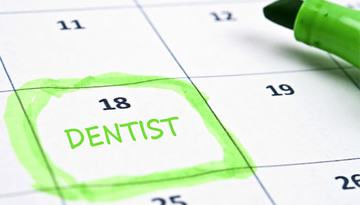 Image of a calendar with a dentist appointment scheduled