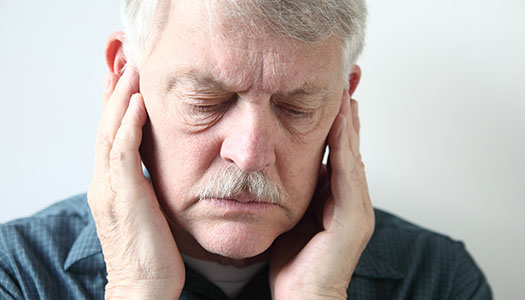 Image of a man with TMJ pain