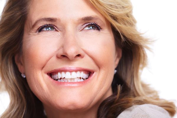 Woman smiling with her dental implant